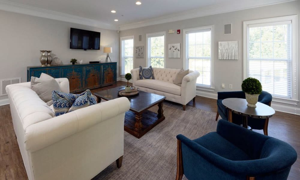 Modern clubhouse with comfortable seating at Worthington Luxury Apartments in Charlotte, North Carolina