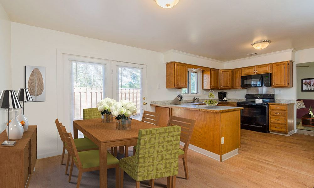 Dining area and kitchen view at Eagle Meadows Apartments in Dover, Delaware