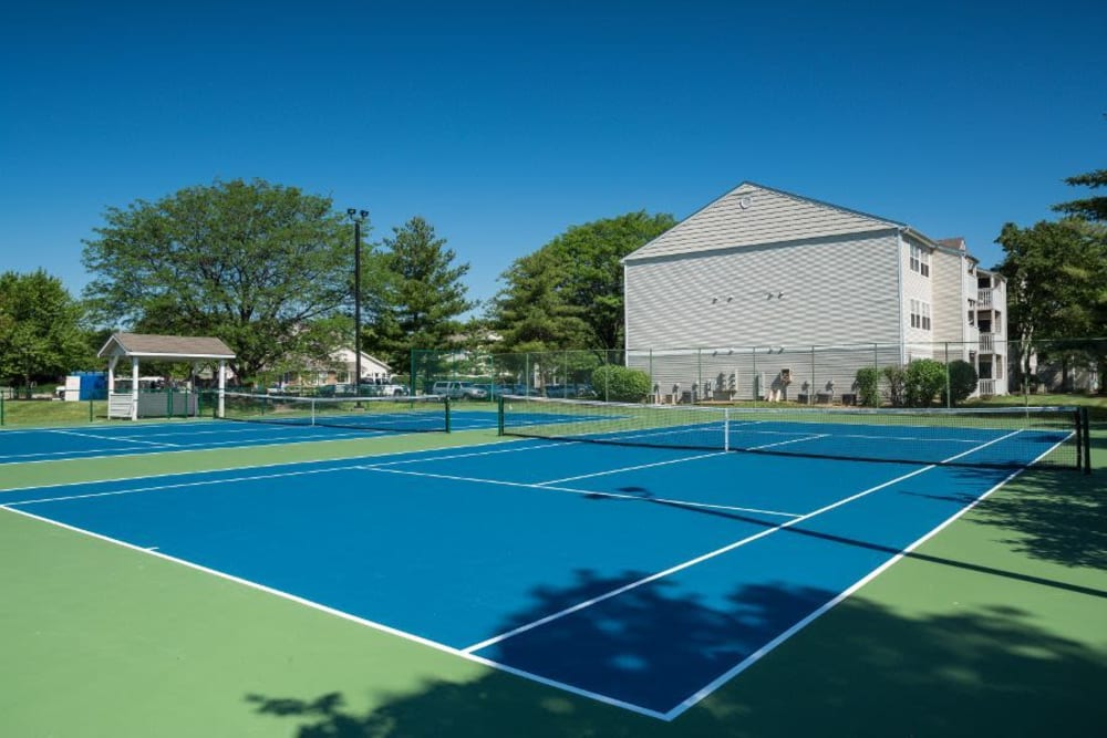 Two full-size tennis courts at Greenway Chase in Florissant, Missouri