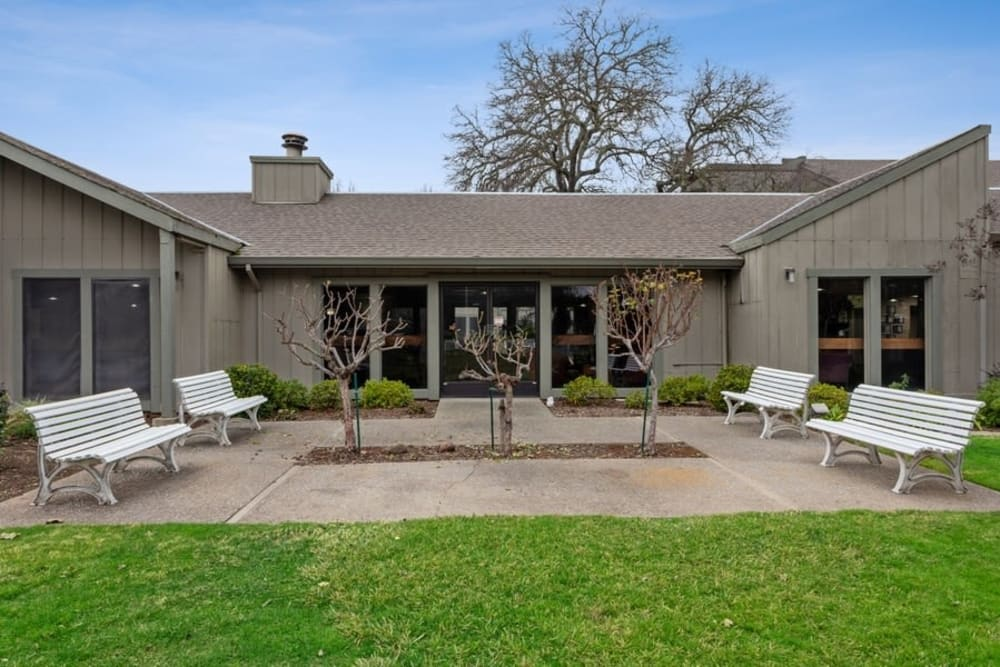 Courtyard with benches and lawn at The Crest at Citrus Heights in Citrus Heights, California