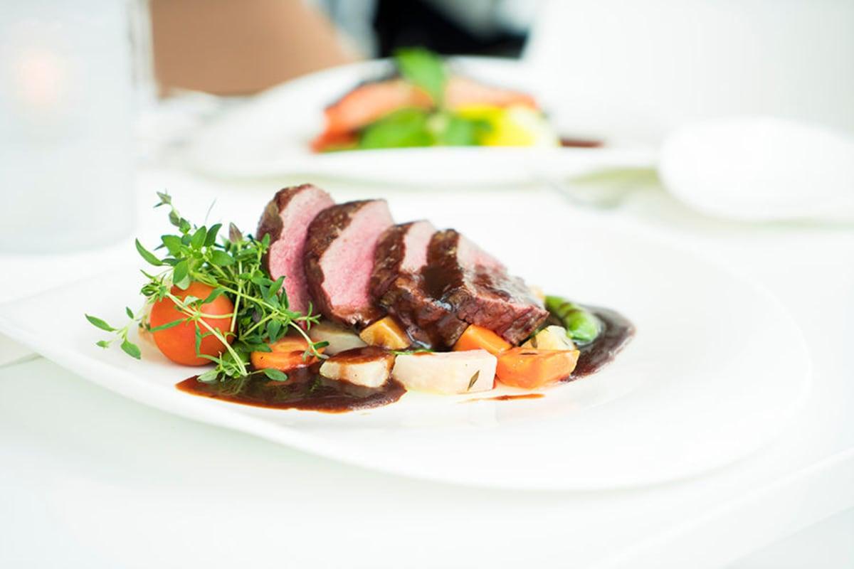 Steak dinner at Oxford Villa Active Senior Apartments in Wichita, Kansas