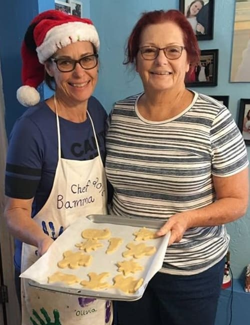 Staff members baking cookies at Inspired Living in Sugar Land, Texas.