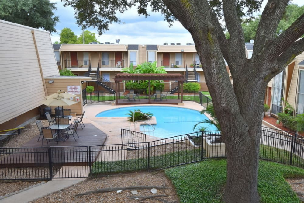 Falls of Maplewood Apartments offers a modern swimming pool in Houston, Texas