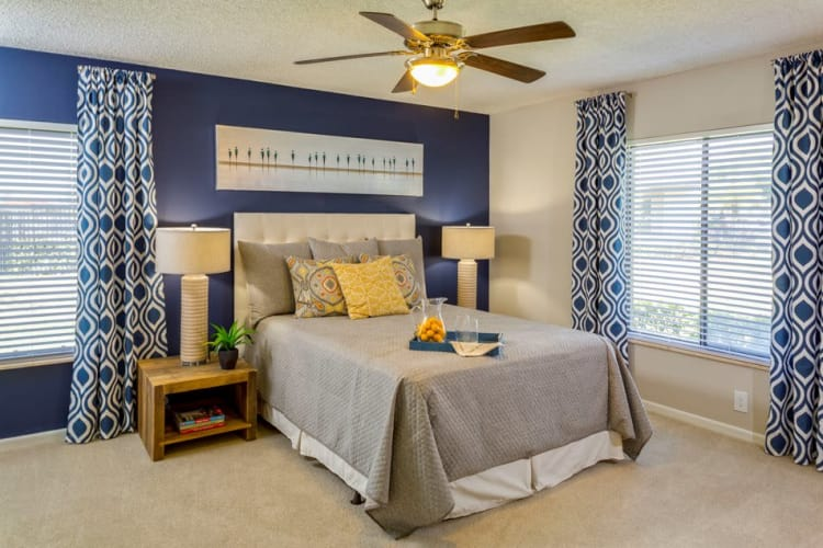 Spacious bedroom with ceiling fan in model home at Verse at Royal Palm Beach in Royal Palm Beach, Florida