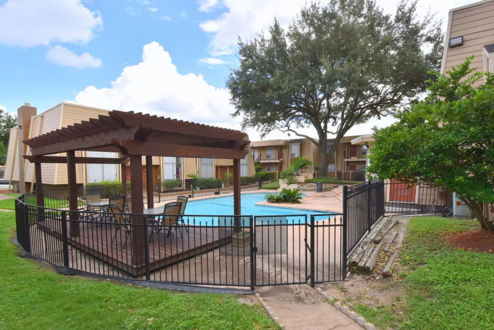 Gated swimming pool at Falls of Maplewood Apartments in Houston, Texas