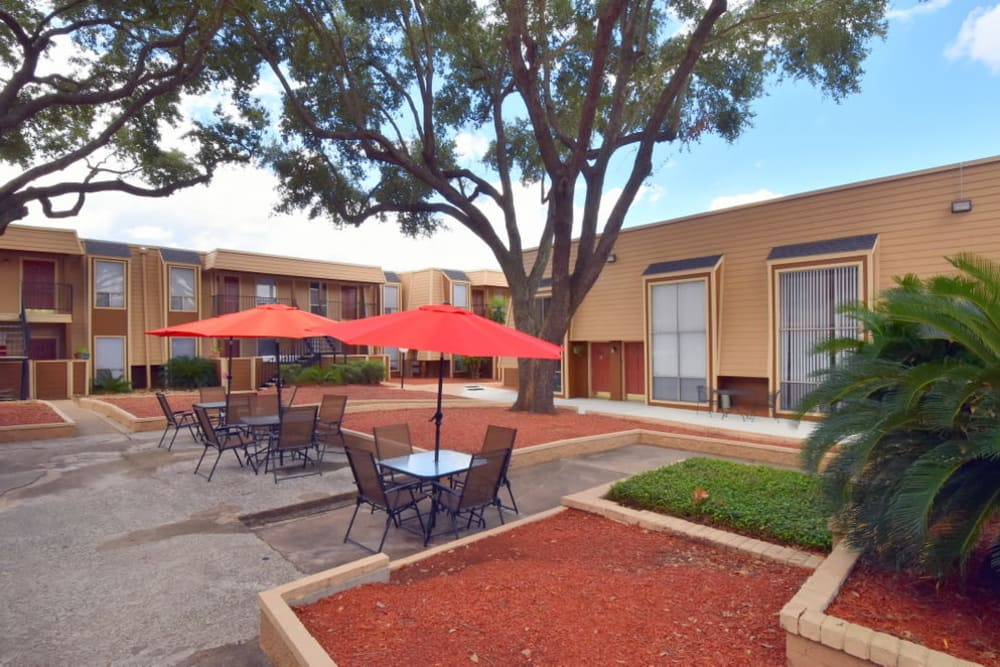 Community patio area at Falls of Maplewood Apartments in Houston, Texas