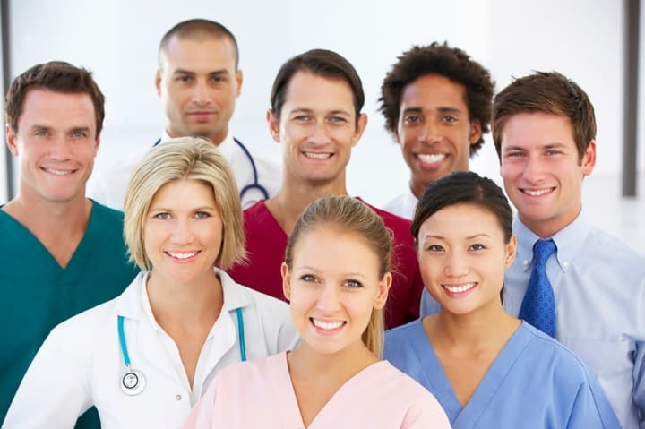 Health care professionals taking a group photo.