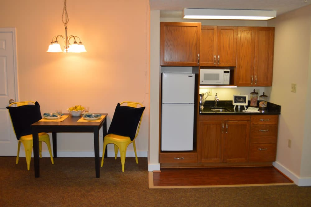 Resident kitchenette and dining table at The Willows at Springhurst in Louisville, Kentucky