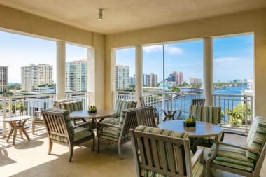 Covered patio seating at The Meridian at Waterways in Fort Lauderdale, Florida.