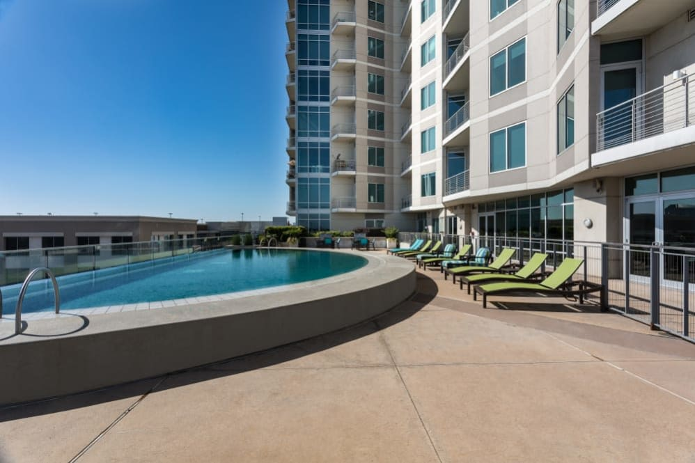 Poolside with lounge seating at The Heights at Park Lane in Dallas, Texas