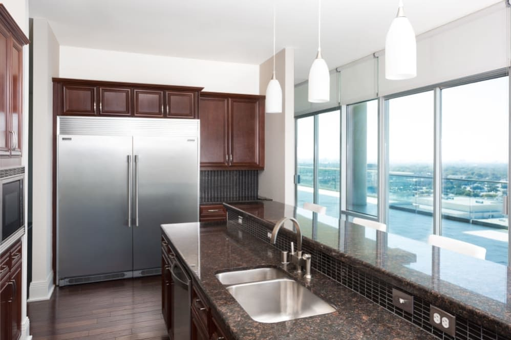 Kitchen with dark cabinets at The Heights at Park Lane in Dallas, Texas