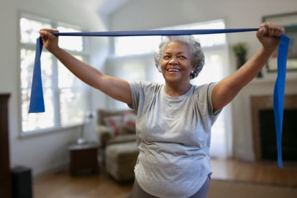 Laughing resident exercising at RockBrook Memory Care in Lewisville, Texas