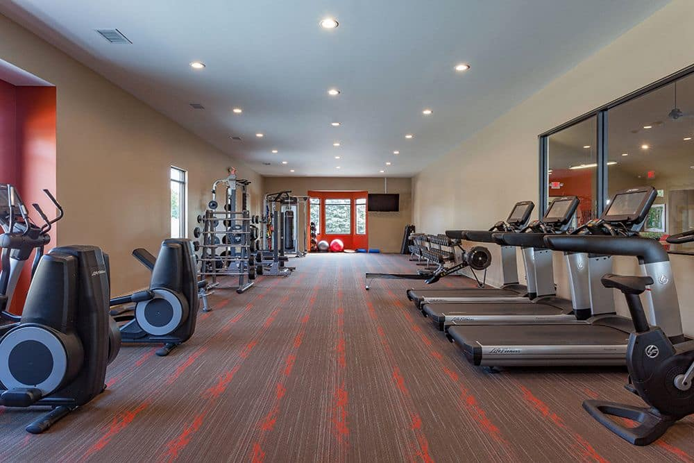 Fitness center at The Trilogy Apartments