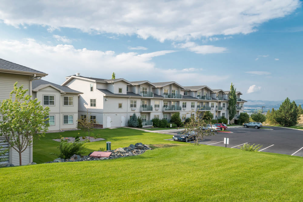 Apartment buildings and parking lot at Touchmark on Saddle Drive in Helena, Montana