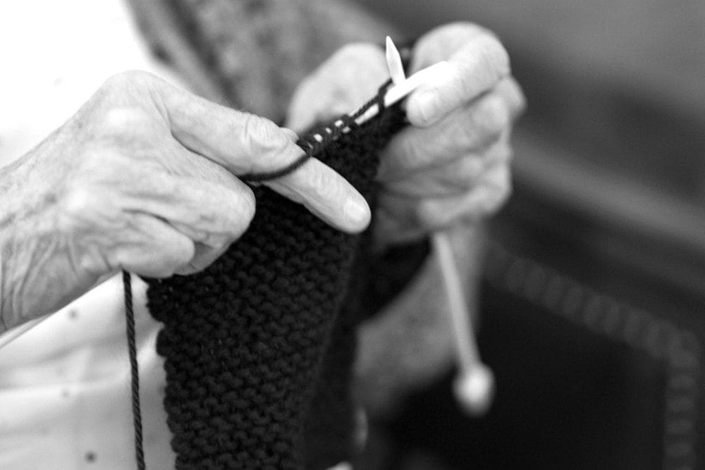 A resident knitting at Gables of Ojai in Ojai, California