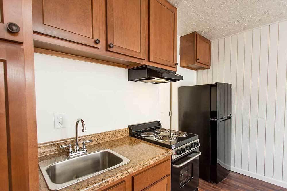 Kitchen with black appliances at Brockport Landing in Brockport, New York