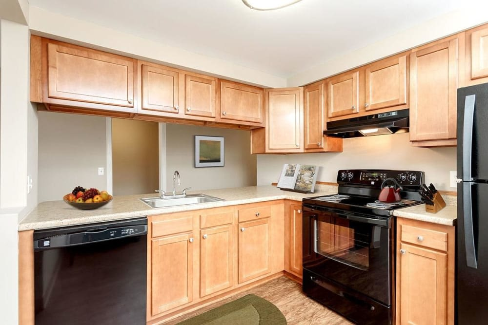 Kitchen with black appliances at Manlius Academy in Manlius, New York