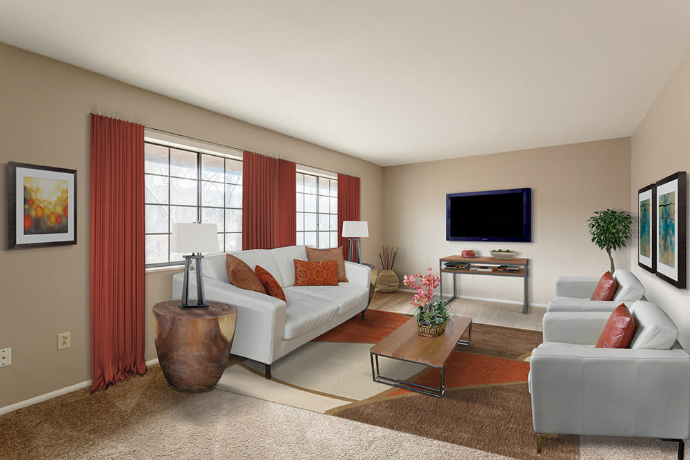 Beautifully designed living room at The Residences at Covered Bridge in Liverpool, New York