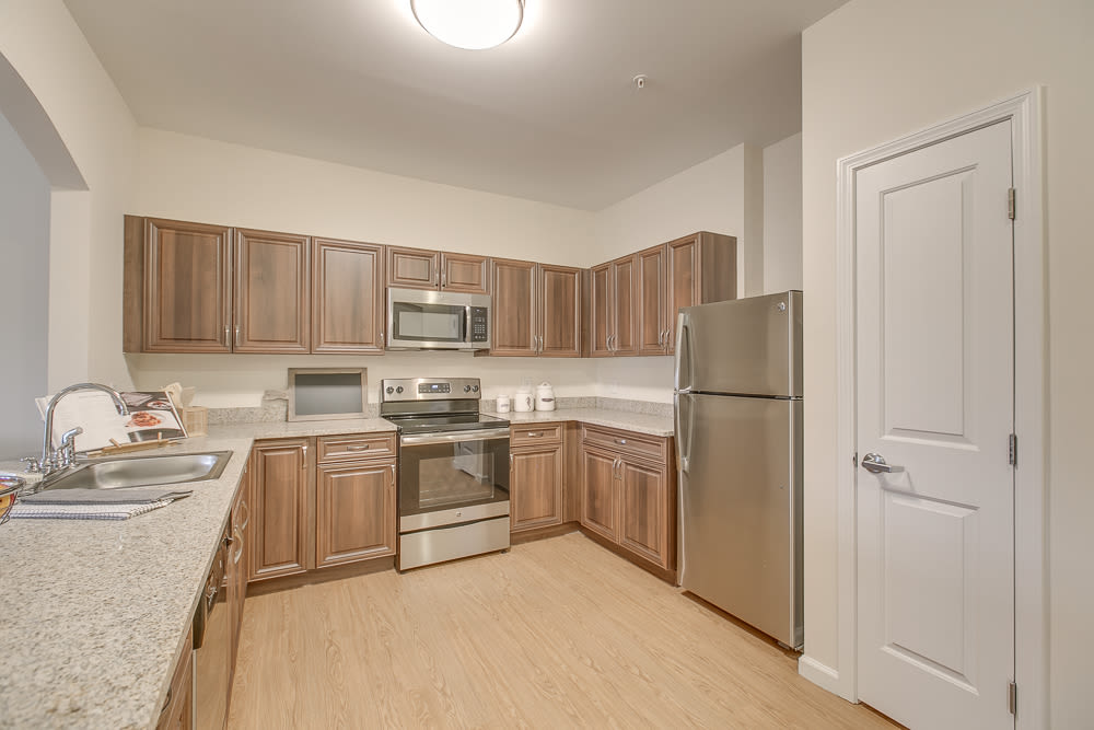 An apartment kitchen with stainless steel appliances at Harmony at Victory Station in Murfreesboro, Tennessee