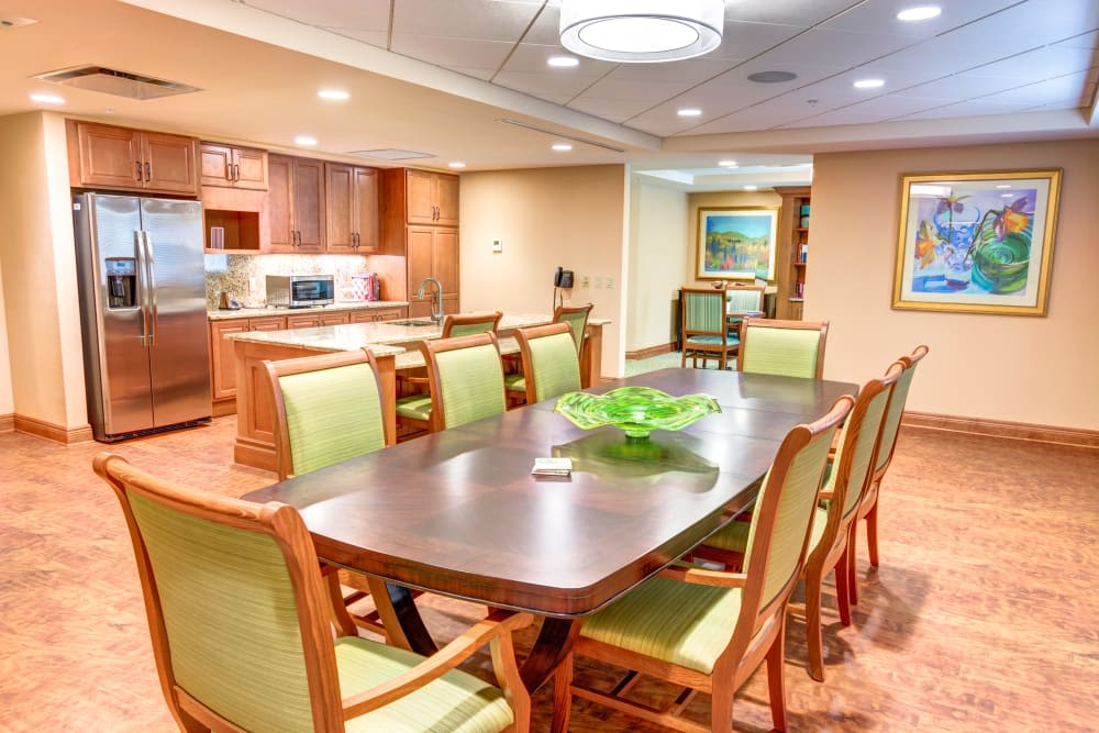 Kitchen and dining area at The Meridian at Boca Raton in Boca Raton, Florida.