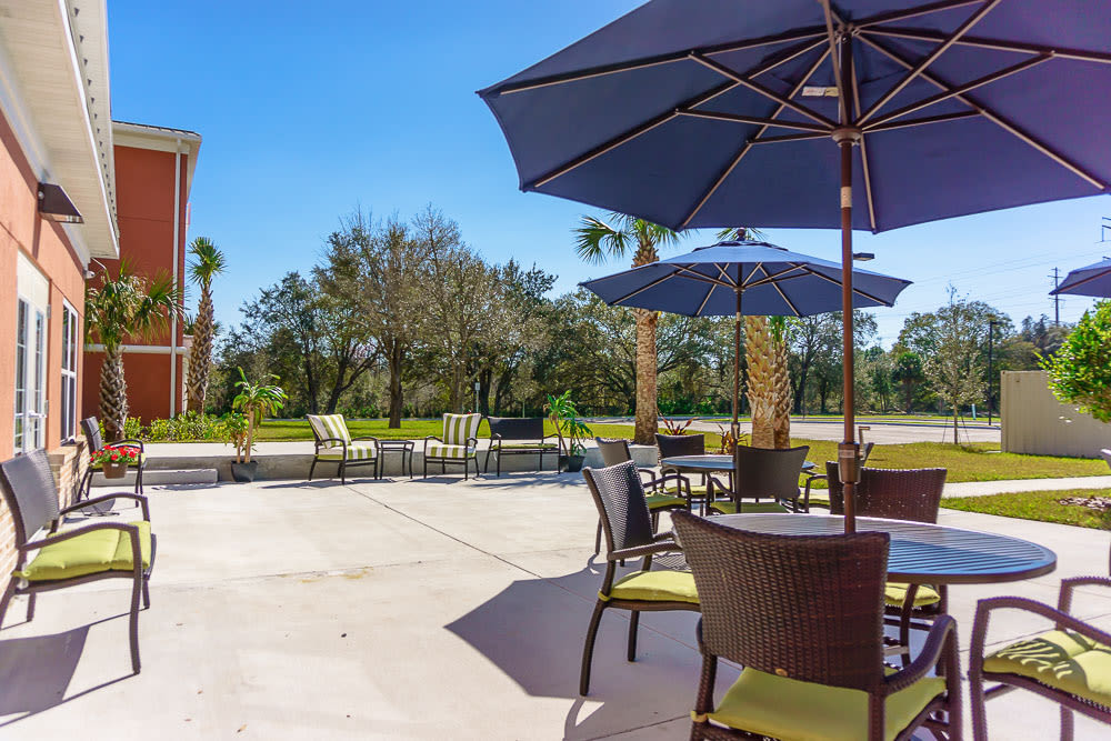 Outdoor patio with seating at Gentry Park Orlando in Orlando, Florida