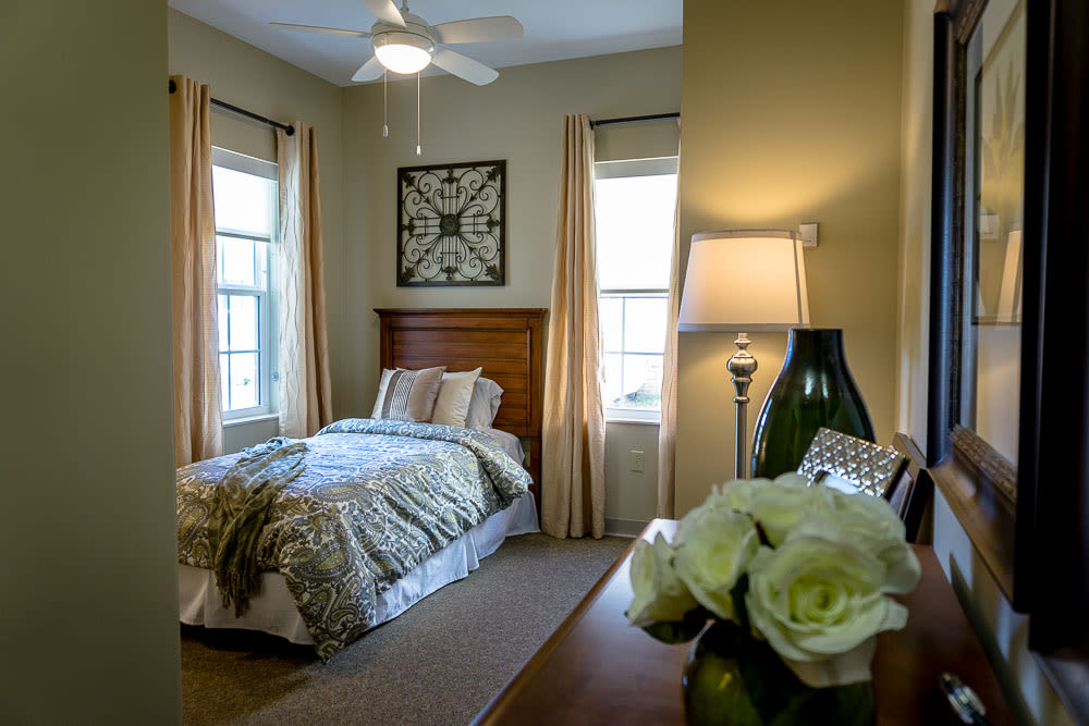 A cozy apartment bedroom at Gentry Park Orlando in Orlando, Florida