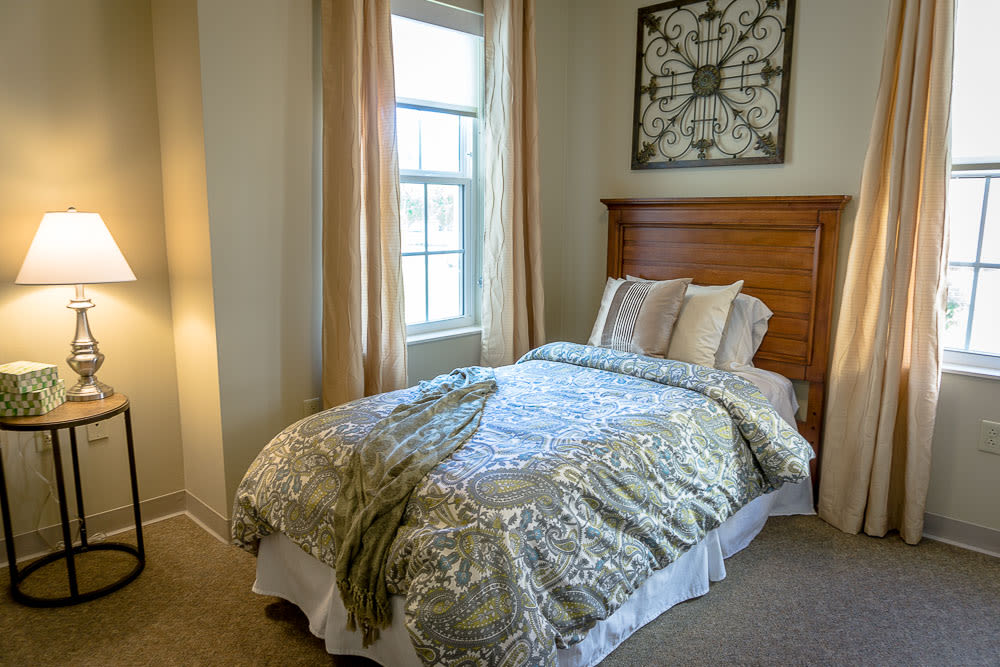 A furnished apartment bedroom at Gentry Park Orlando in Orlando, Florida