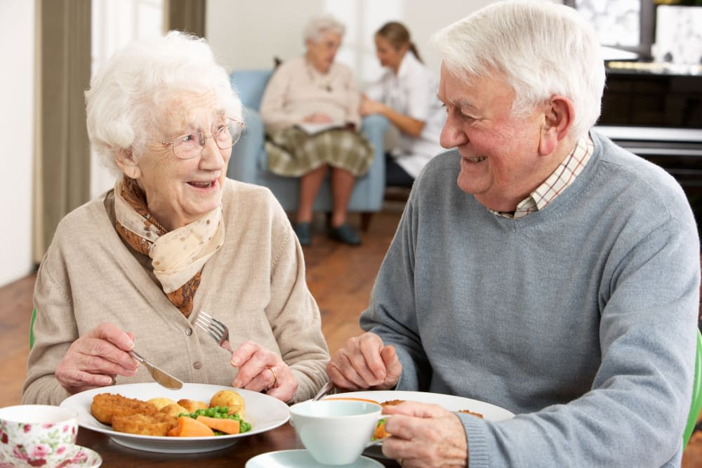 Two residents eating a meal together at Harmony at Eastchase in Montgomery, Alabama