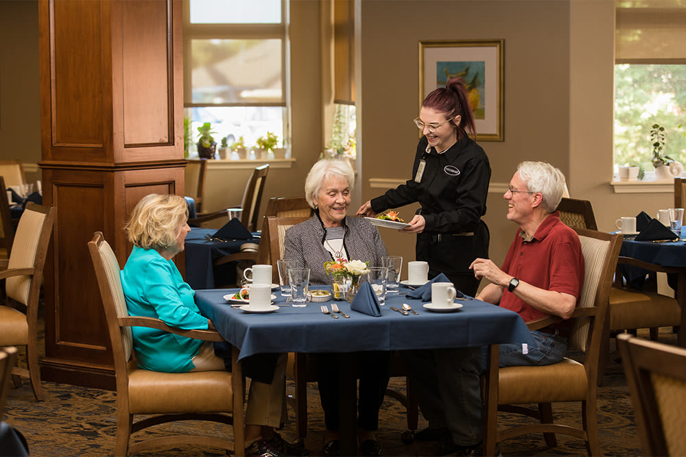 residents being served dinner