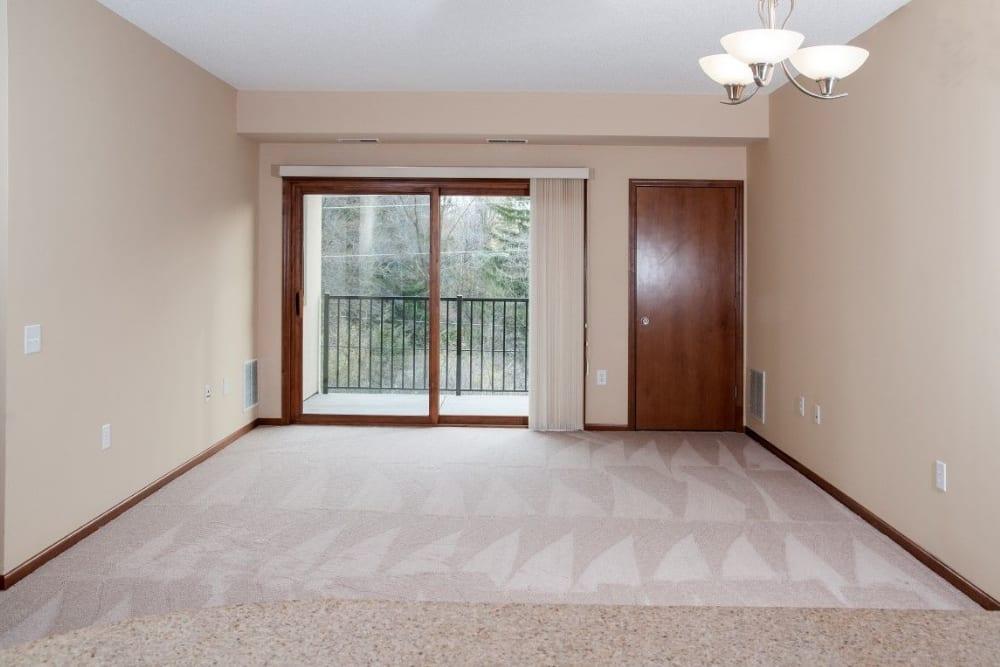 Spacious living room with patio access at Oaks Glen Lake in Minnetonka, Minnesota