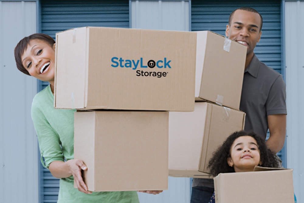 Family putting boxes in their new storage unit at StayLock Storage in Leesburg, Georgia