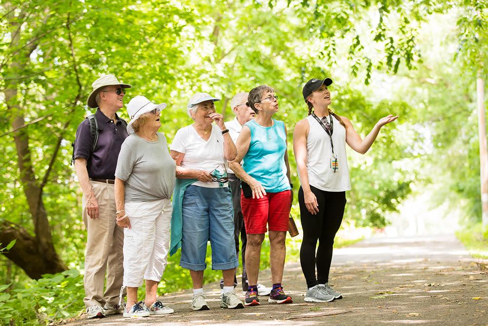 senior residents taking a group walk outside