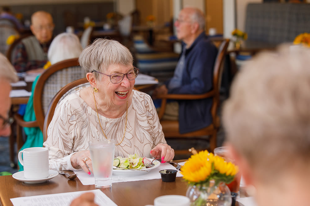 Residents Enjoying Lunch In The Main Dining Room