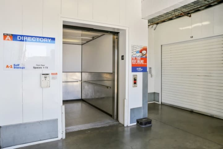 A view of an interior hallway and large elevator at A-1 Self Storage on Vineland in North Hollywood, California.
