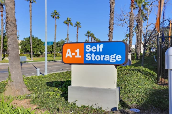 The front sign for A-1 Self Storage in Kearny Mesa welcomes all visitors to the facility along Copley Drive.