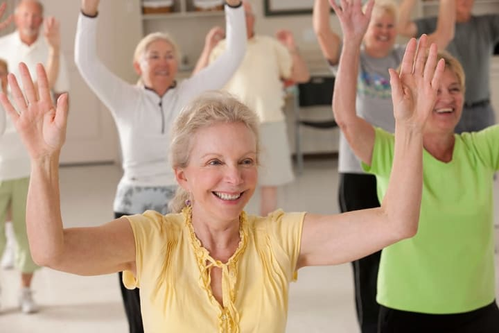 Female seniors attending an exercise class.