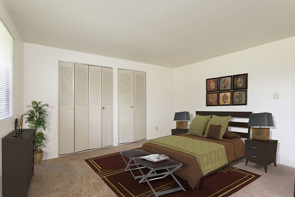 Bright master bedroom at High Acres Apartments & Townhomes in Syracuse, New York