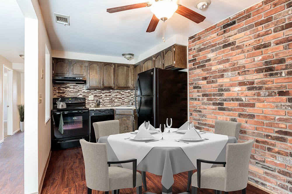Well-equipped kitchen and dining room at Raintree Island Apartments in Tonawanda,New York