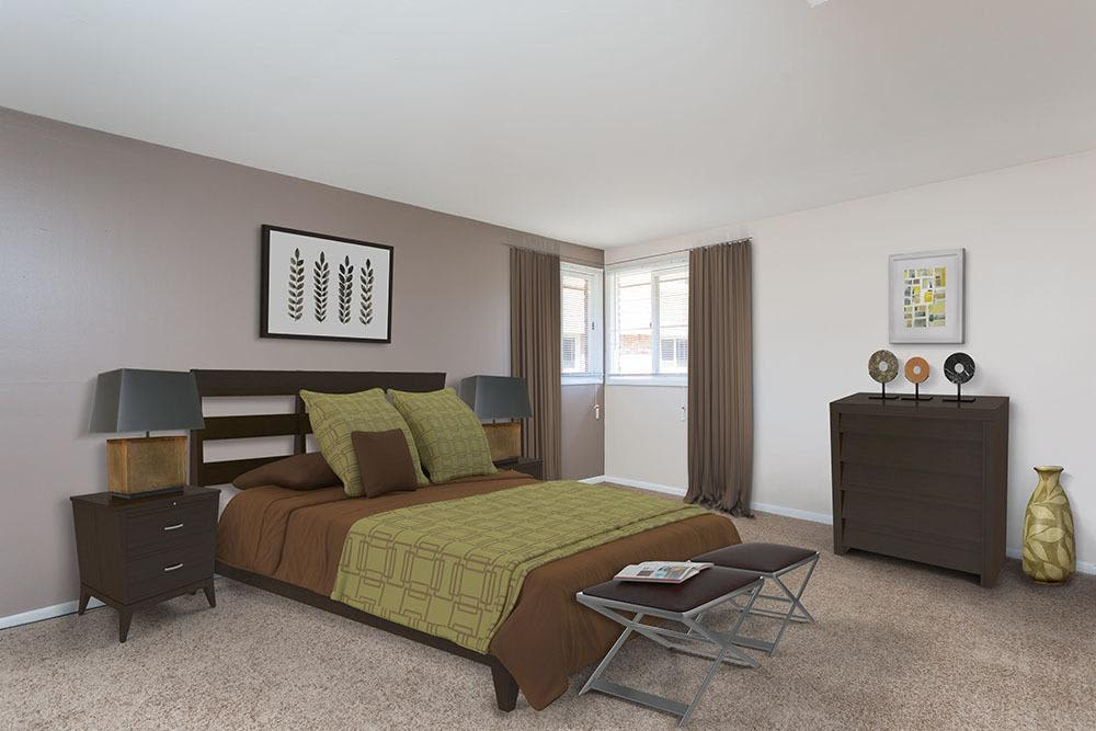 Well decorated bedroom at Raintree Island Apartments in Tonawanda, New York