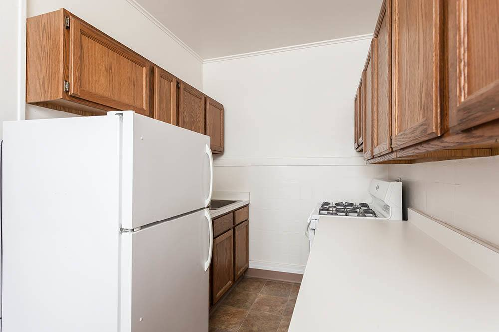 Galley kitchen at Colby, Carlton, and Colby Park Apartments in Rochester, New York