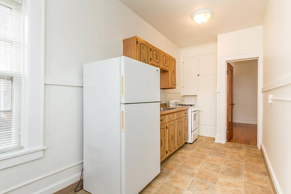 Spacious kitchen at Colby, Carlton, and Colby Park Apartments in Rochester, New York
