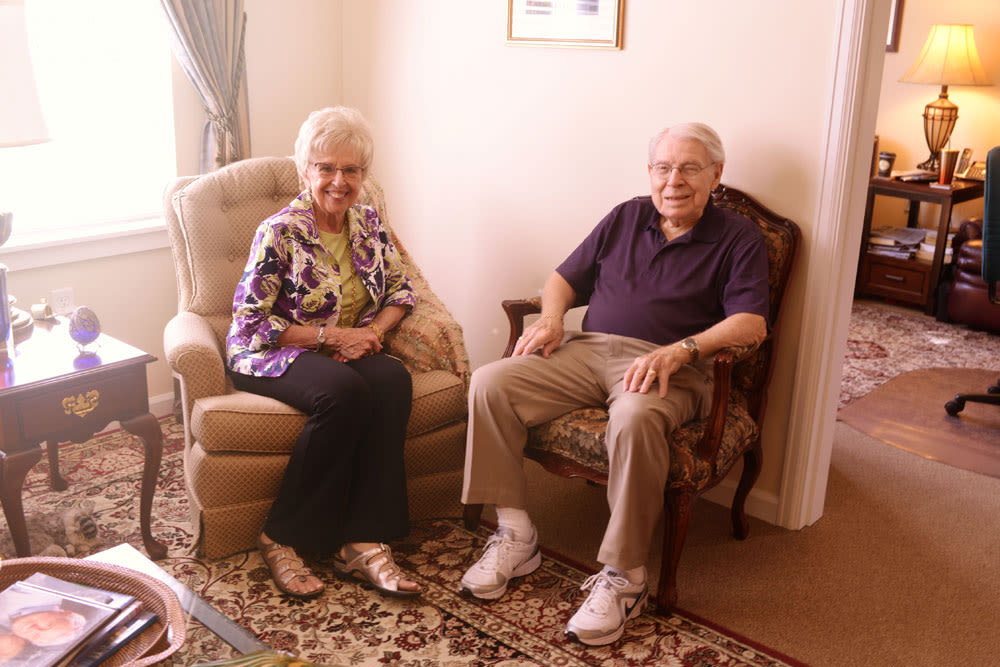 Resident couple sitting in recliner chairs at Quail Park at Browns Point in Tacoma, Washington