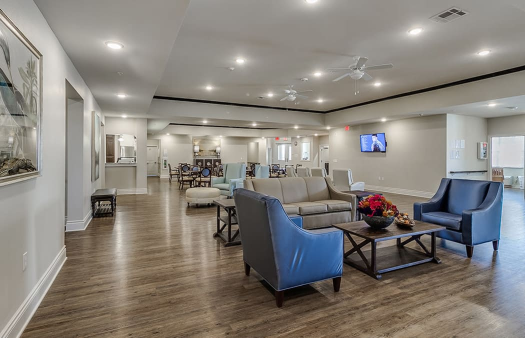Iris Memory Care of Rowlett Great Room with comfortable chairs facing a flat-screen television.