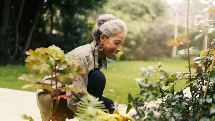 African-American-woman-gardening-in-Orland-Florida-assisted-living-community