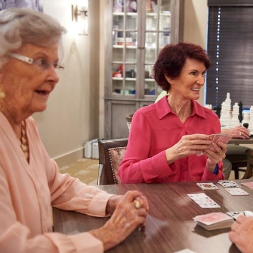 Residents enjoying a card game at The Crossings at Eastchase in $Montgomery, Alabama