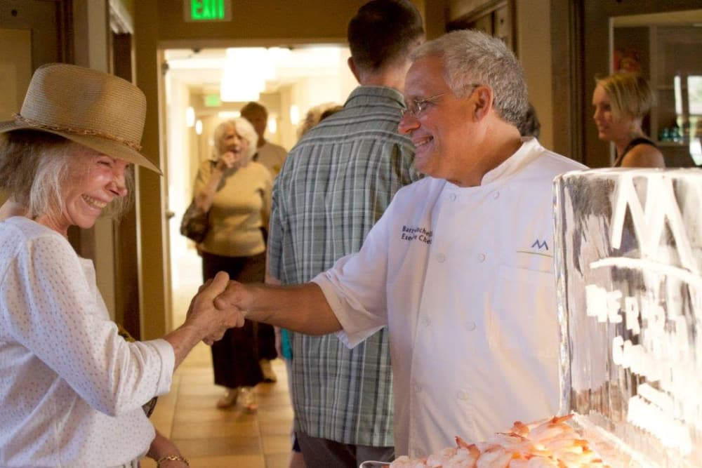 Barry Minchella, Executive Chef at Anthem shaking hands with resident