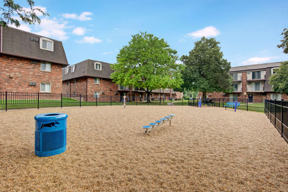 Large dog park area for owners and their furry friends to enjoy at Blackhawk Apartments in Elgin, Illinois