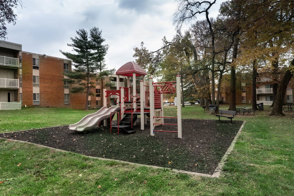 Children's playground surround by grass at The Glendale Residence in Lanham, Maryland