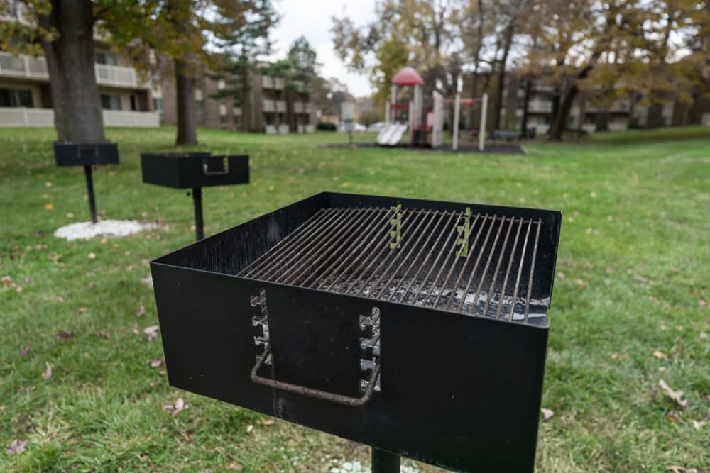 Charcoal grill surrounded by grass for a picnic at The Glendale Residence in Lanham, Maryland