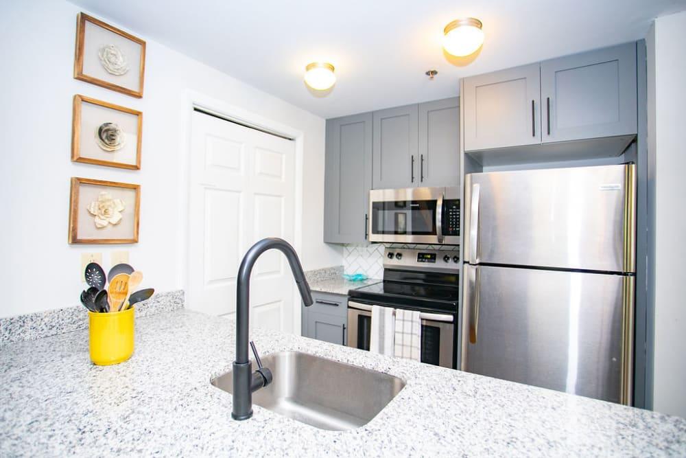 Fully-equipped kitchen at Newnan Lofts Apartment Homes in Newnan, Georgia